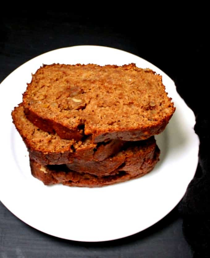 Top shot of four slices of banana nut bread, stacked