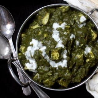 A vegan Palak Paneer recipe that's as good as anything you'd get at an Indian restaurant, perhaps even better. The spinach is creamy and spiced perfectly. Cubes of superfirm tofu make a healthier and delicious option for the vegan cheese, paneer, that's typically used in this north Indian recipe. Eat with a naan or roti for the perfect Indian meal. A vegan, gluten-free recipe.
