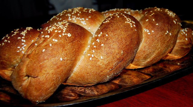 A beautiful, braided vegan challah bread that;s whole wheat