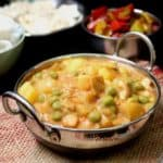 A creamy vegan peas potato curry that comes together in minutes. #vegan, #curry, #potatoes, #indian HolyCowVegan.net