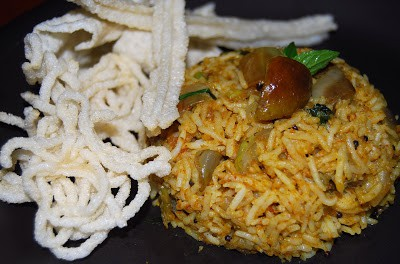 Vangi Bhath or Tamil eggplant rice served with fried vatrals or poppadums.