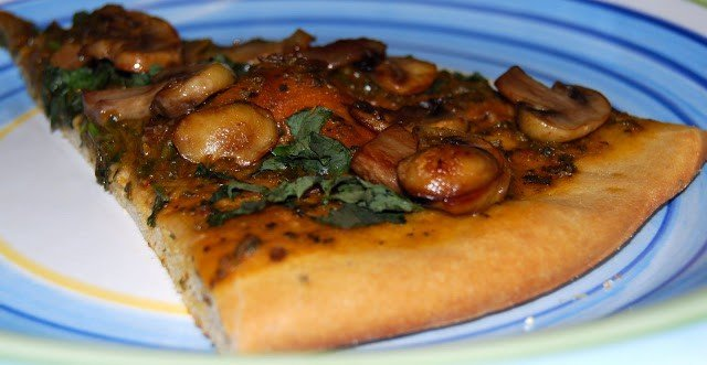 Vegan Basil Pizza slice with mushrooms