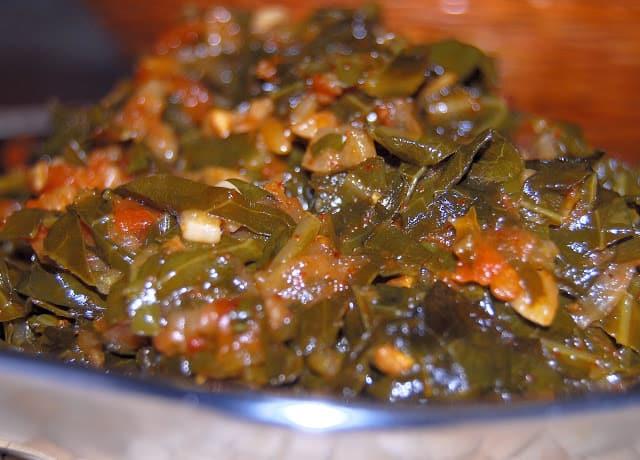 Kashmiri collard greens in a steel bowl