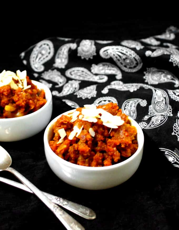 Front shot of two bowls of carrot halwa, a carrot pudding from India