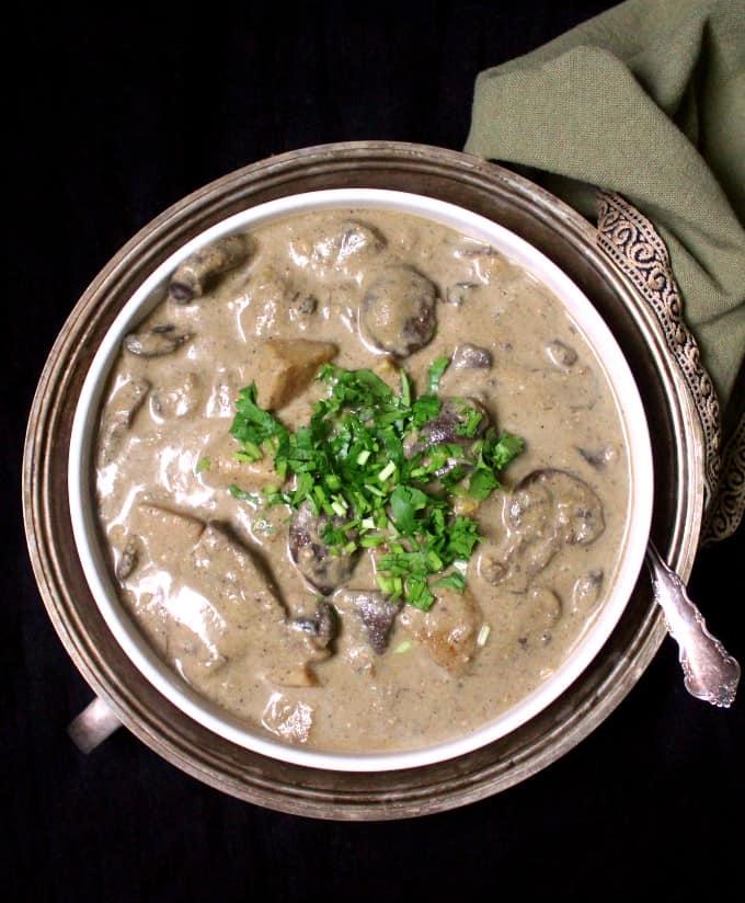 Overhead shot of Malaysian Mushroom Korma in a white bowl.