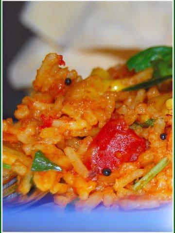 Tomato rice in a blue dish