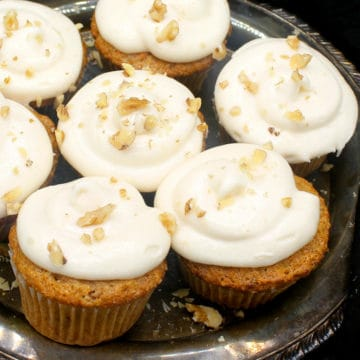 Close up of vegan carrot cupcakes with vegan cream cheese frosting
