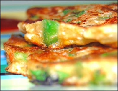 Savory vegan pancakes stacked on a plate