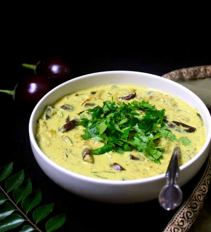 Front shot of a bowl of eggplant curry with turmeric and coconut milk