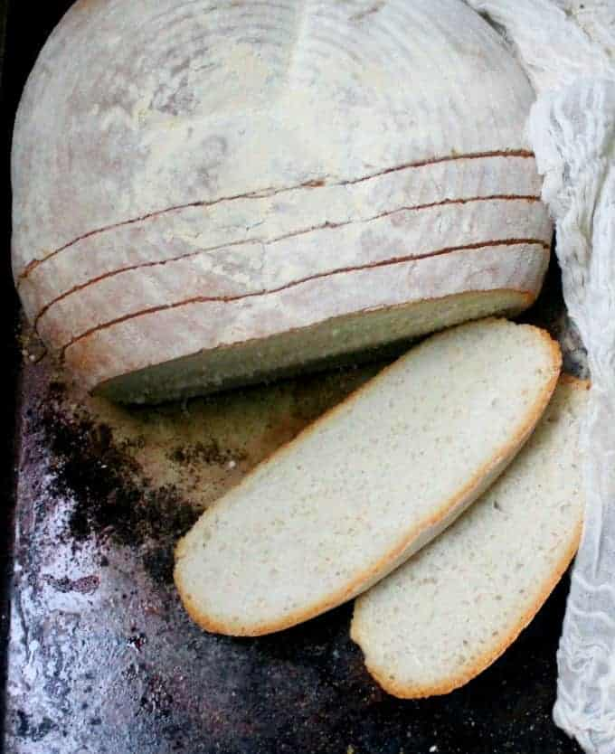 Slices of Tuscan bread, or Pane Toscano, on a baking sheet