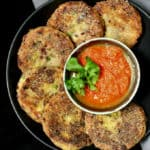 Delicious and crispy, these Mexican Potato and Bean Cakes served with a fresh tomato sauce are the perfect appetizer or snack -- but they are nutritious enough to make a great meal too! #vegan #mexican #cincodemayo #potatoes HolyCowVegan.net