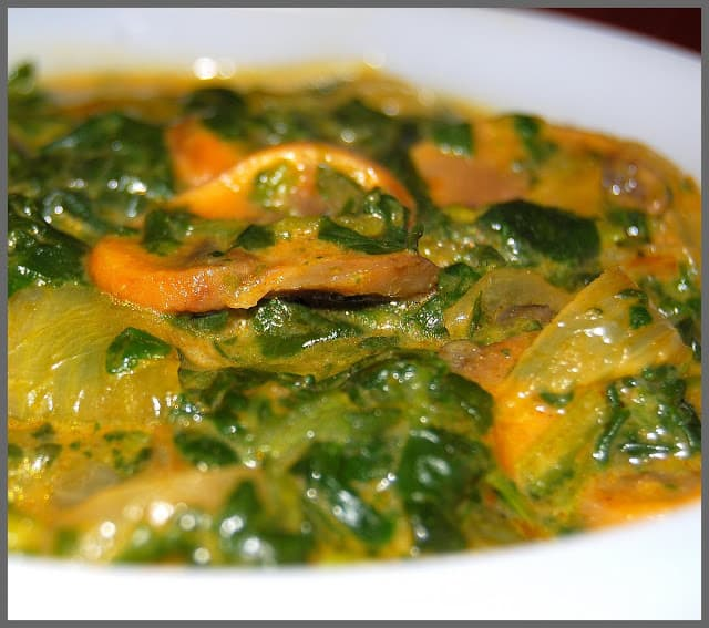 Mushroom Spinach Curry in white bowl