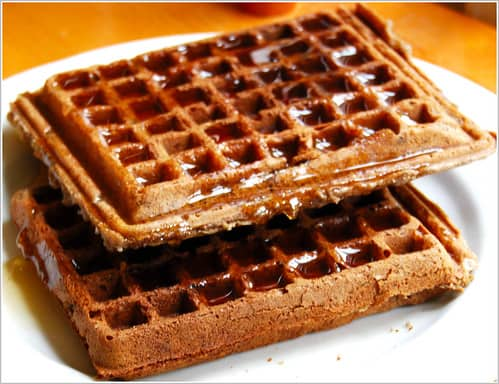 Vegan Buckwheat Waffles stacked on a white plate