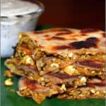 Vegan murtabak cut into pieces with the stuffing showing