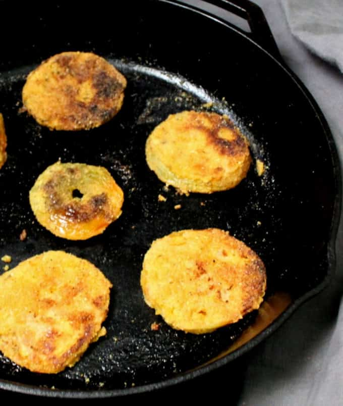 A cast iron skillet with fried green tomatoes