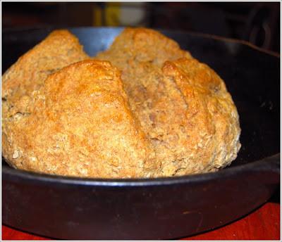 An Irish vegan whole wheat soda bread in a cast iron pan.