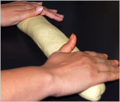 Rolling the French bread loaf