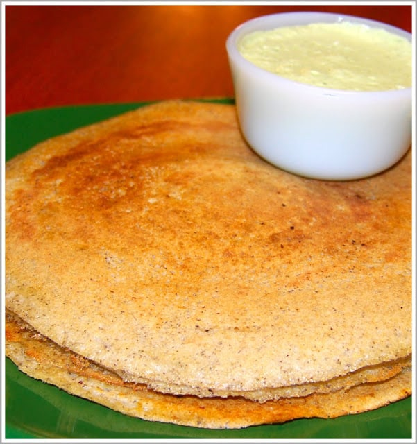 A stack of brown rice dosas with coconut chutney