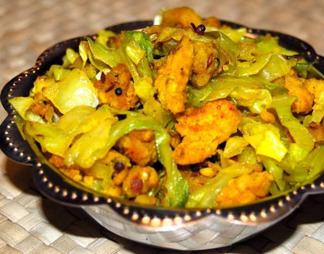Closeup of cabbage paruppu usili in a steel bowl.