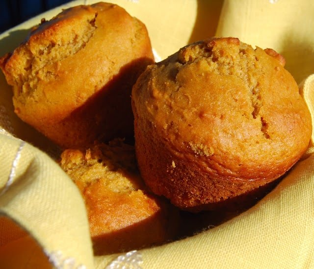 Photo of vegan butternut squash muffins nestled together on a yellow napkin.