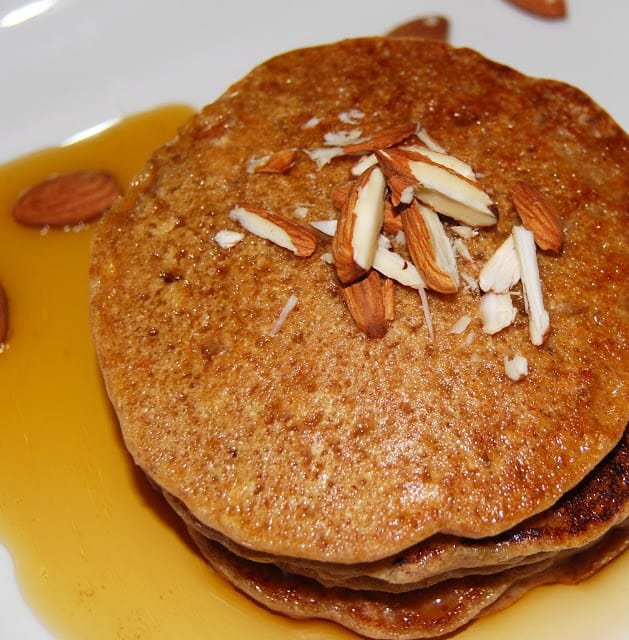 Overhead shot of vegan almond pancakes with chopped almonds.