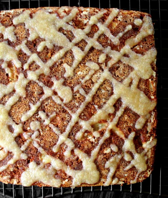 Top shot of a vegan apple cake with a drizzle of applesauce glaze