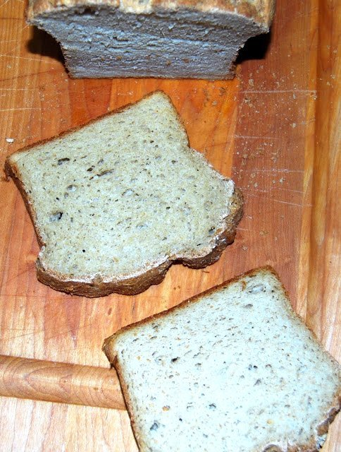 Photo of two slices of vegan gf sandwich bread on a chopping board.