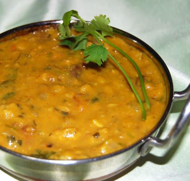 Closeup of dhabay ki dal with cilantro.