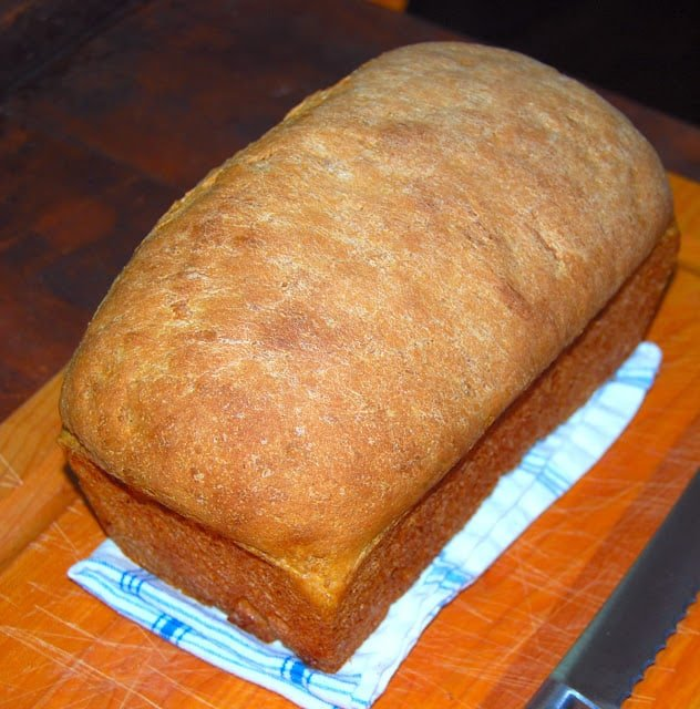 Photo of a full loaf of whole wheat bread.