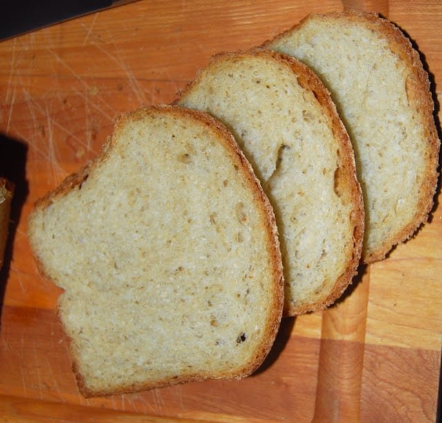 Photo of three slices of whole wheat bread.