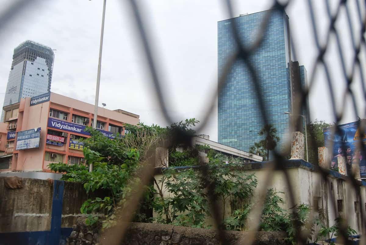 Skyscrapers rise alongside slums in Mumbai.