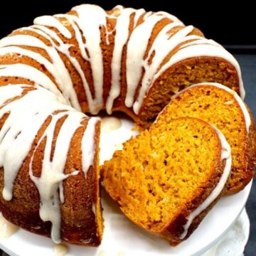 Closeup of vegan pumpkin cake with chai spices and cream cheese glaze with two slices cut