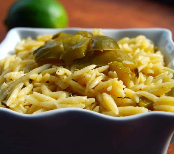 Close up photo of Lime Orzo with bell peppers in a white bowl.