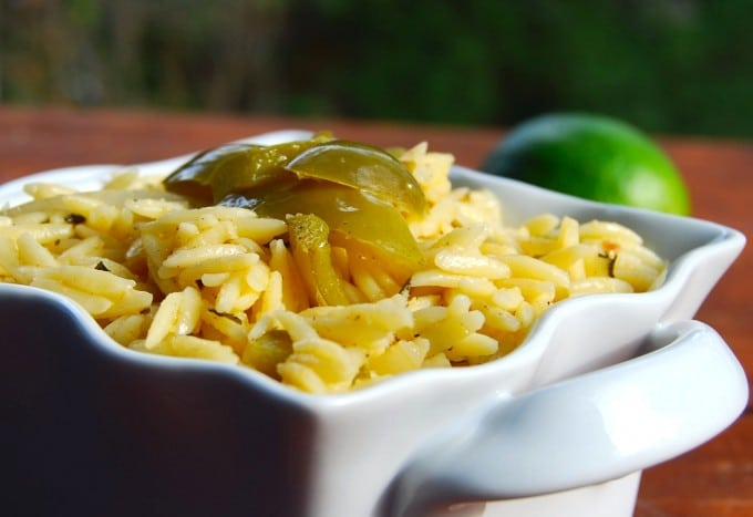 Lime Orzo in a white bowl with bell peppers.