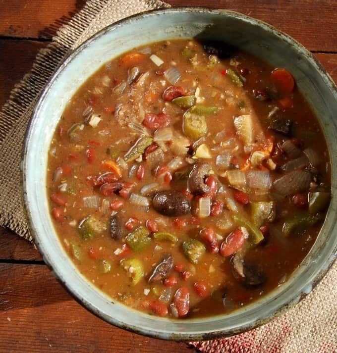 Overhead shot of a large bowl of a nourishing, gluten-free, vegan gumbo with beans, okra and served with brown rice.