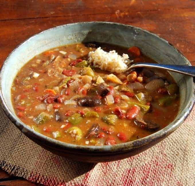 This delicious, gluten-free vegan gumbo has no added fats, and it is packed with delicious beans, okra, mushrooms, thyme and sage. Serve with some brown-rice for a tasty and healthy meal.