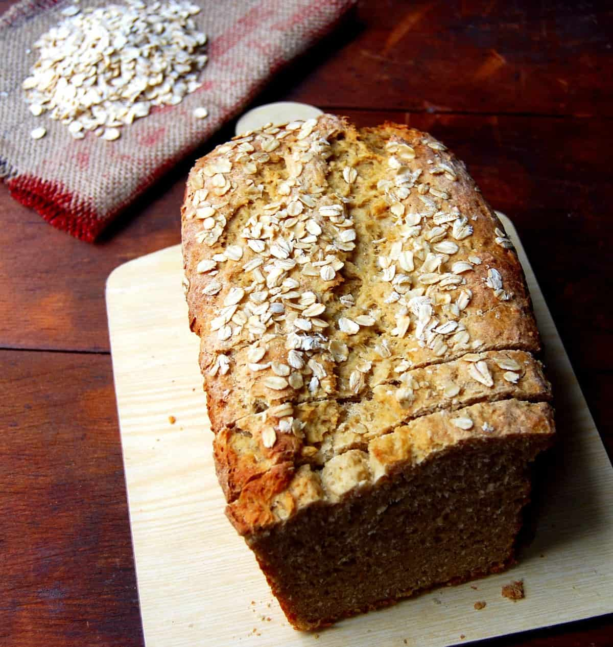 Photo of vegan Applesauce Sandwich Bread on a cutting board.