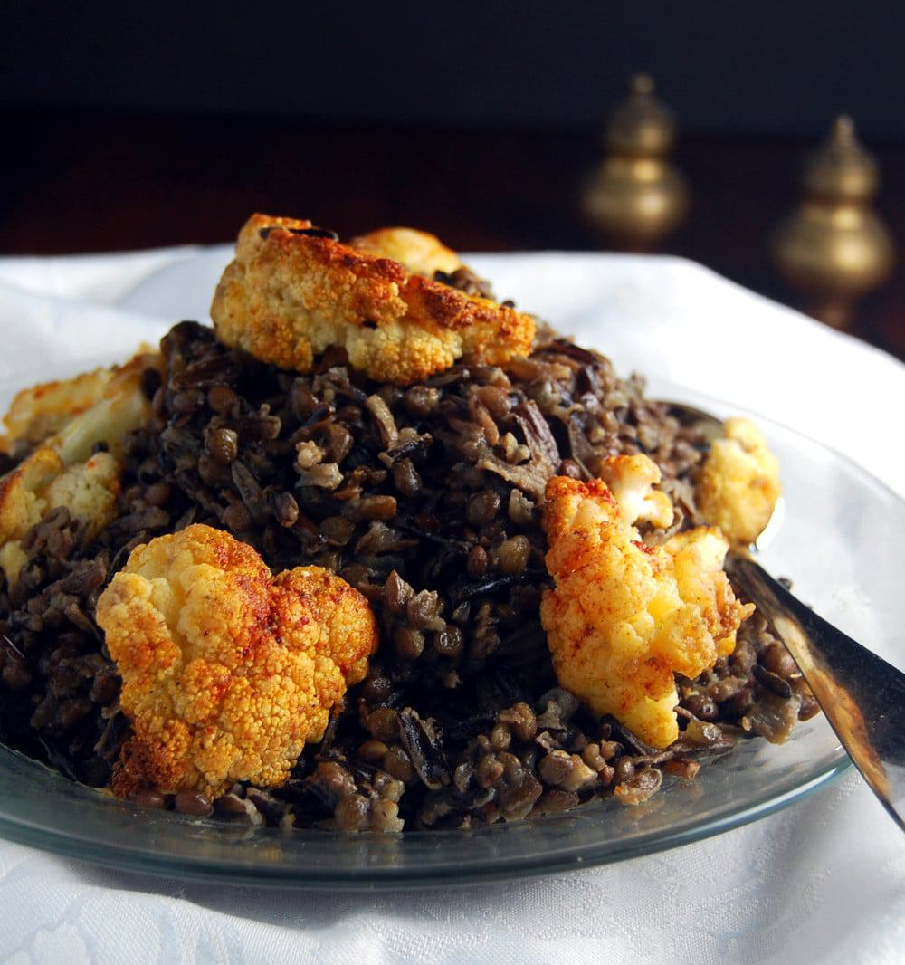 Cauliflower WIld Rice Pilaf in glass plate with salt and pepper shakers