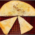 Berber Pizza is a covered North African pizza stuffed with onions