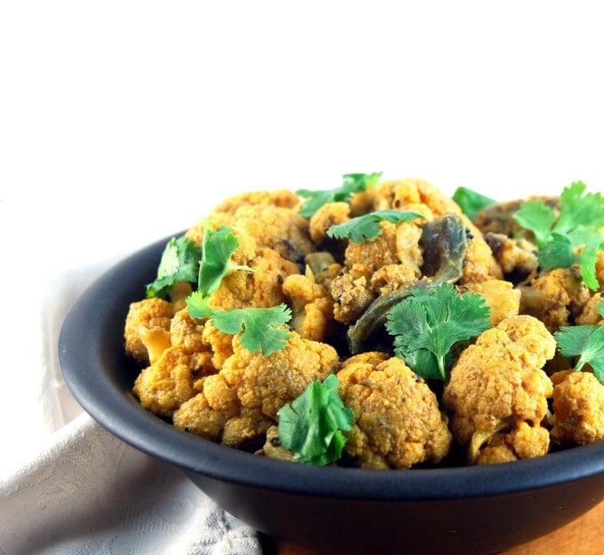 A bowl of Gobi Achari with cilantro.