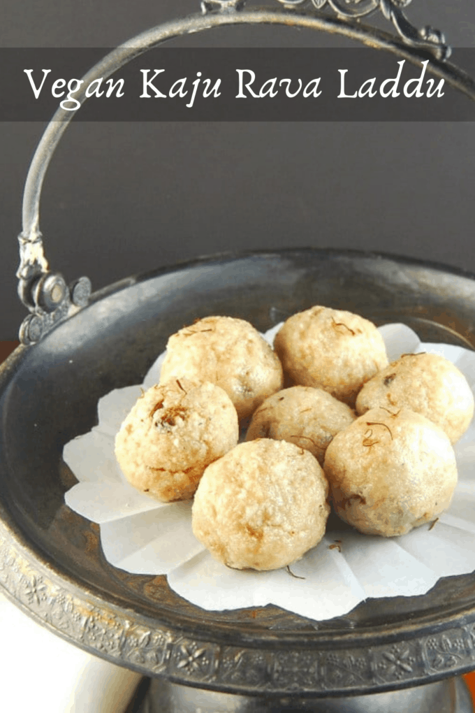 Kaju Rava Laddu in a silver serving dish with an ornate design against a gray background