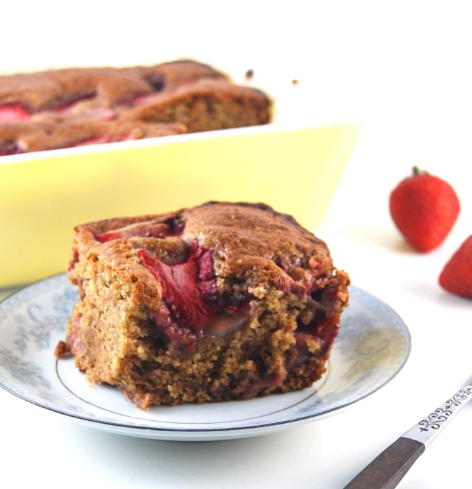 Front photo of a slice of vegan strawberry bread