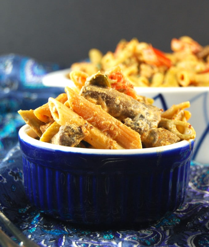 Pasta with Vegan Sausage and Greens in a blue bowl.