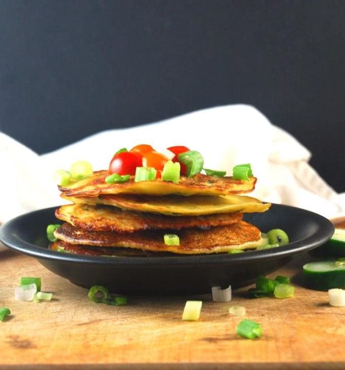 Savory Cucumber Pancakes on a black plate.
