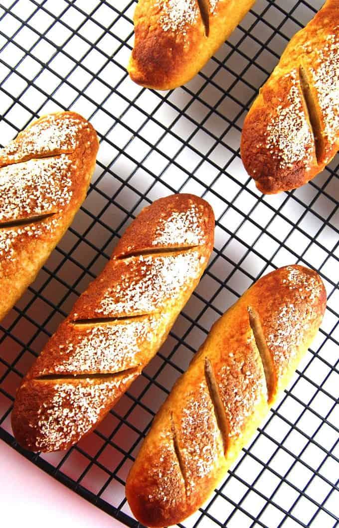 Pretzel hot dog buns on a cooling rack.