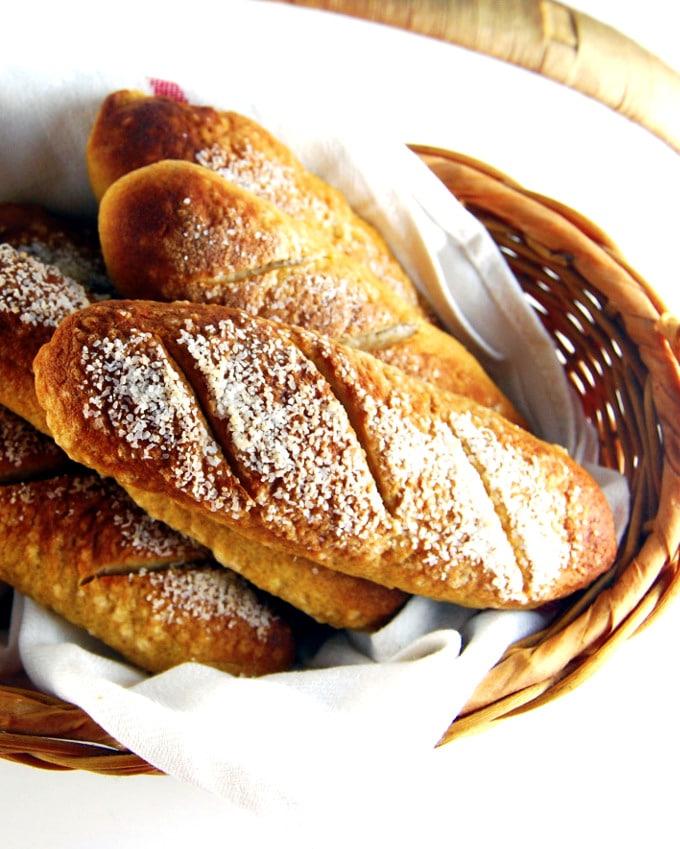 Vegan hot dog pretzel buns in a basket.