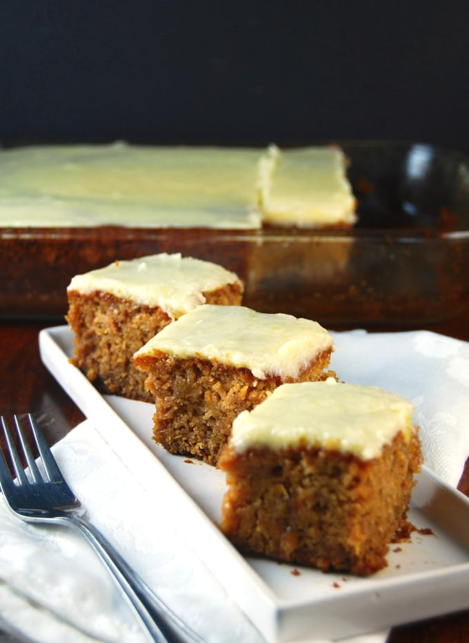 Vegan Squash Cake with Pineapple Frosting squares in a white plate.