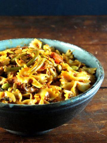 Farfalle with Chorizo and Greens. Vegan, sauce is gluten-free.