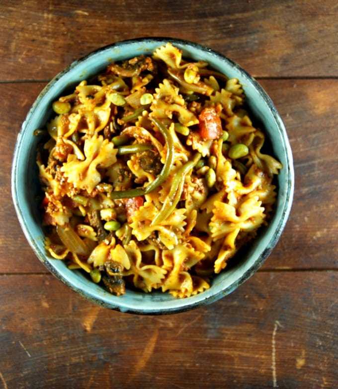 Overhead shot of vegan Farfalle with Chorizo and Greens in a bowl.