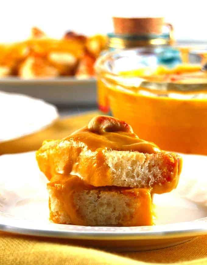 Mango Shahi Tukda, a decadent Indian dessert made by smothering bread in a creamy sauce, Vegan.